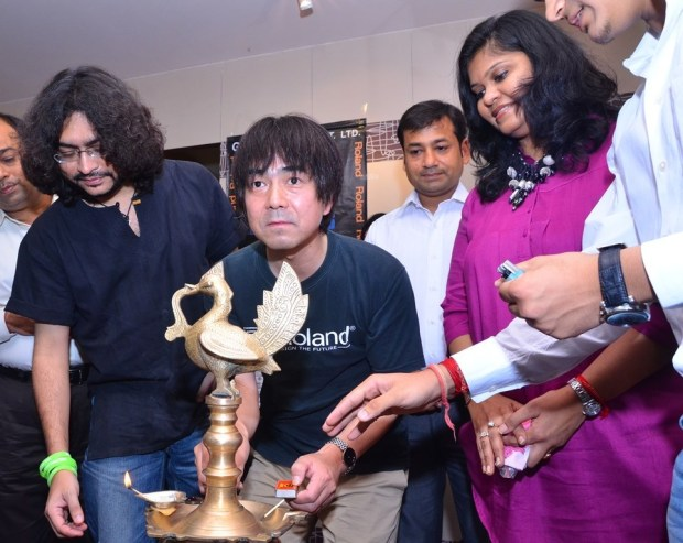 Inauguration by lighting the lamp at Press Meet and Launch of India's first Roland School of Music Japan at Happy Hours with Rupam Islam, Shigeru Kimoto, Mrs. Jyoti Bansal,