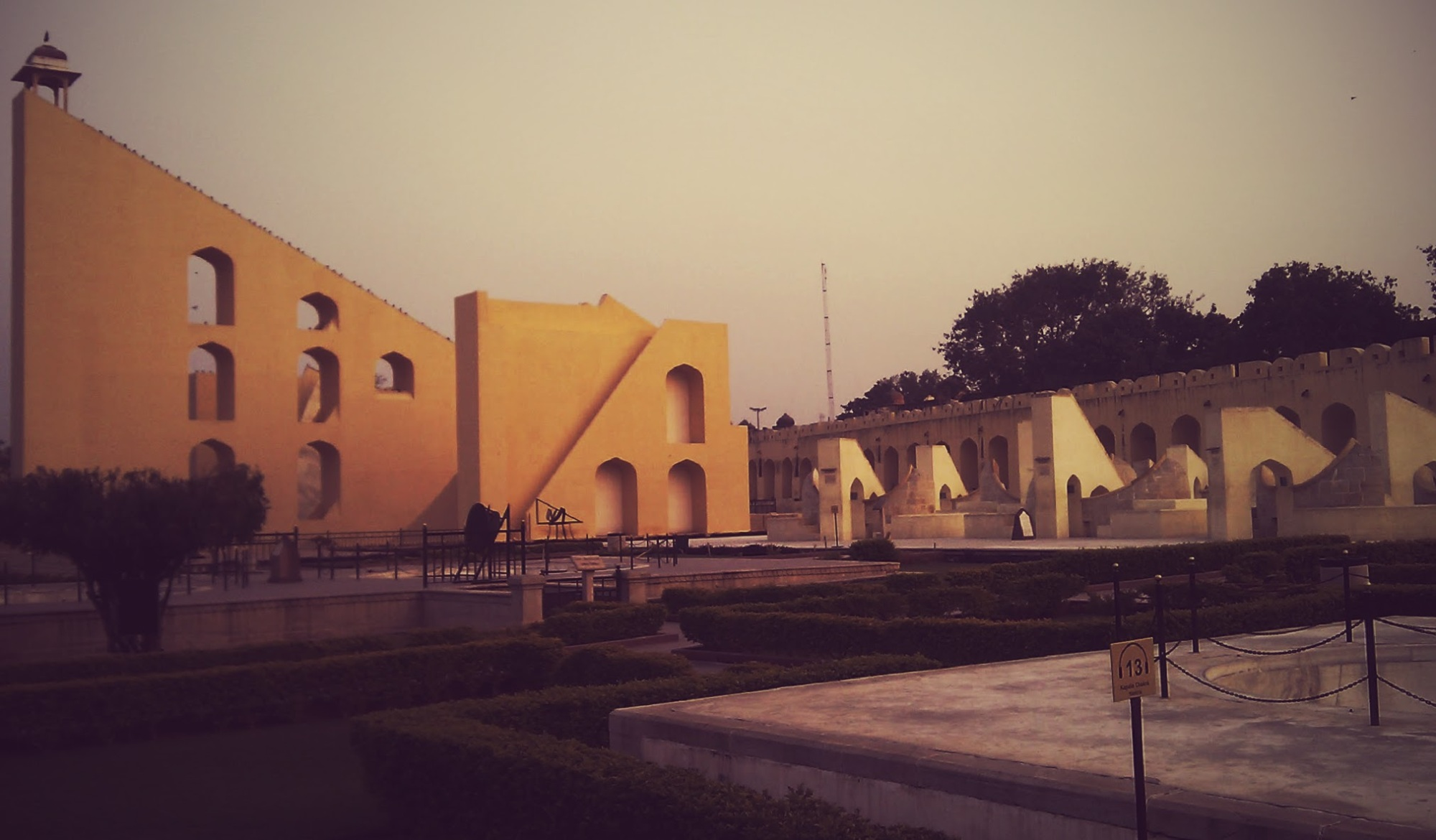 The giant sundial, also know as the Samrat Yantra, in Jantar Mantar complex in Jaipur. Those specks along the sloping edge of the sundial are pigeons - all dutifully lined up as twilight approaches. (Dec. 2011)