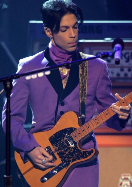 Prince performed onstage at the 2006 BET Awards in a stylish grape-colored ensemble.